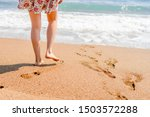 Woman Walking On The Beach To...