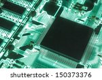 Green electric circuit of a computer - stock photo