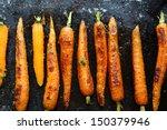 baked carrots on a baking sheet ... | Shutterstock . vector #150379946
