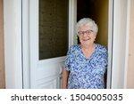 Elderly Senior Woman Opening...