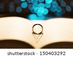 Ring On A Book With A Heart...