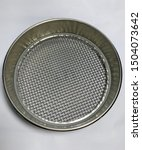 Angled top shot of a strainer or sieve. Standard sieve no. 5 with 4 mm eye.