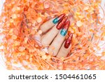 Small photo of Sparkling red glitter Gel Nail Art with shiny dark green glitter gradation design for Christmas nail painting on acrylic extension stiletto style long fingernail