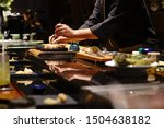 Japanese Chef Making Uni Nigiri ...