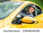 Image Of Happy Driver In Plaid...