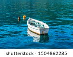 White Wooden Boat In Turquoise...