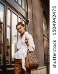 outdoor fashion portrait of...   Shutterstock . vector #1504942475