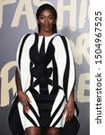 Small photo of LONDON, UK. September 14, 2019: Tiwa Savage at the Fashion for Relief Show 2019 at the British Museum, London. Picture: Steve Vas/Featureflash