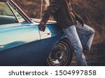 Countryside Oldtimer Getaway. Caucasian Driver and His Classic Car in Some Remote Place. - stock photo