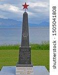 Small photo of Harstad (Noway) 07-07-2019 A classic Soviet monument built of red stone commemorates the 800 men who lost their lives 1941-1945