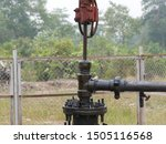 polished rod, stuffing box and tee part of pumpjack - stock photo