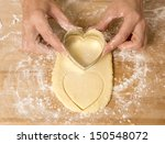 Hands Pressing Heart Shaped...