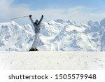Joyful Female Skier Rising Her...