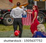 Small photo of Holt, Norfolk, UK – September 14 2019. Male and female dancers giving a jive dance demonstration at the 1940's weekend at the forties festival held in Holt Norfolk