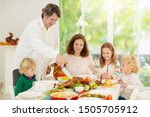 Family With Kids Eating...