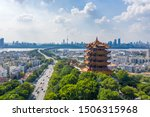 "Aerial view of  Wuhan city .Panoramic skyline and buildings beside yangtze river.4 Chinese letters on tower is ""Nang Xiong Gao Gong"" means ""amazing heaven"""