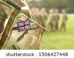 UK flag on soldiers arm. UK military uniform. United Kingdom troops