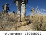Soldiers Walking In Desert  Lo...