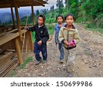 Small photo of GUIZHOU, CHINA - APRIL 10: Unidentified Chinese teenagers aged 12 years and stroll around the neighborhood of Basha village, April 10, 2010. Basha Village, Congjiang County.