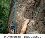 Hands Of Male Rock Climber...