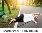 Small photo of Asian elderly people stumbled legs myself or tripped over something,sick senior woman skid,falling down to the floor because of dizziness,faint,suffering from illness,headache,hypertension in park
