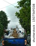 Small photo of Yogyakarta, Indonesia, January 17, 2019: The sculpture symbolical from Buddhist (in middle) and Mother Mary (in four beside). About intolerance in Yogyakarta after 10 unresolved cases of intolerance