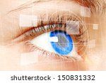 Woman blue eye looking on digital virtual screen close-up  - stock photo