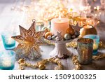 Small photo of Festive christmas decoration table - Still life with opulent arrangement of ornaments