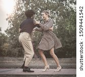 Swing Dancers Couple Stepping...