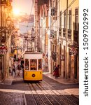 Small photo of LISBON, PORTUGAL - SEPTEMBER 10, 2019: The traditional Portuguese Funicular going up the steep hills of Lisbon in Portugal taking tons of tourists to see the amazing architecture of the city.