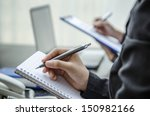business people taking note in... | Shutterstock . vector #150982166