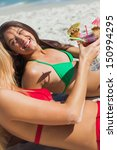 sexy young women on the beach... | Shutterstock . vector #150994295