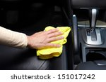 Hand cleaning car seat. - stock photo
