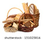 Fresh bread in baskets isolated on white - stock photo