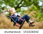 Little Child On Swing