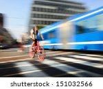 Motion blurred bike in dito traffic - stock photo