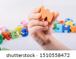 Hand Holding Letter Cube W Of...