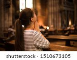 Religious Young Woman Sitting...