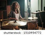Woman Playing Drums During...