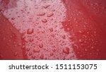 Raindrops On Red Car Hood  Aft...