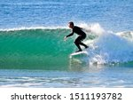 Surfer Racing The Curl Of A...