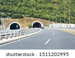 Small photo of Athens / Greece - August 2019. Road tunnel in mountains. Mountain road tunnel Tunnel on the highway. Automobile trip. Pathway with tunnel. Drive through the mountain