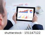 Businessman Analyzing Graph On...