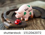 Stock photo lucky symbols with pig horseshoe on wooden background 1512062072