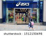 Small photo of LEEDS, UK - JULY 12, 2016: People walk by Asics store in Leeds, UK. Asics is a Japanese sportswear and footwear producer since 1949.
