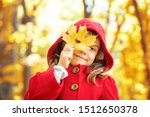 child in a red coat with autumn ... | Shutterstock . vector #1512650378
