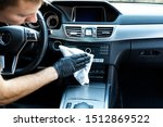 Cleaning the car, cleaning the interior of the car with a microfiber cloth - stock photo