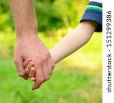 hands  father lead his child in ... | Shutterstock . vector #151299386
