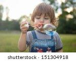 little boy make a soap bubbles... | Shutterstock . vector #151304918