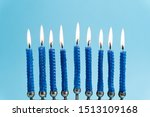 Menorah With Lit Candles In...